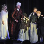 Scrooge sees himself as a young boy with his mother and sister.