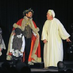 The Ghost shows Scrooge children representing Poverty and Ignorance.