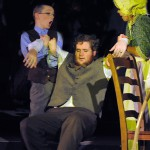 Cratchit faints as Scrooge tells him he will help his family.
