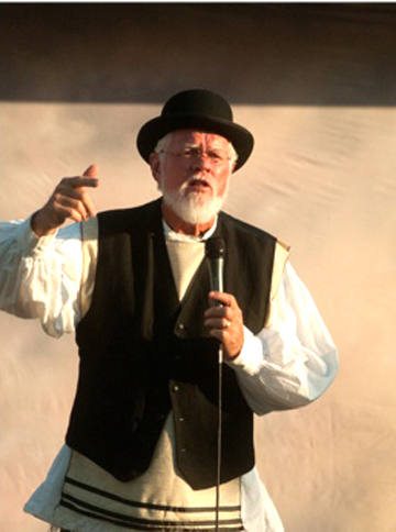 "Avram the Book/Brickseller hawking bricks during ""Fiddler on the Roof"" July, 2012."